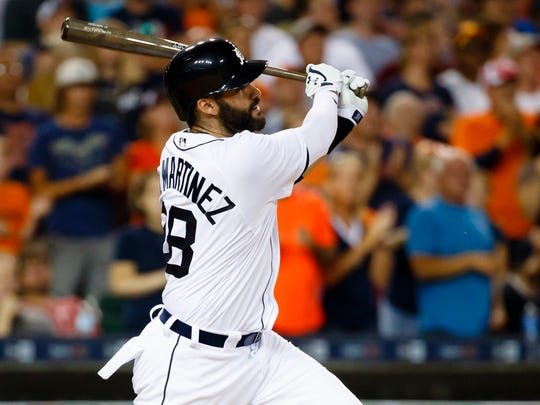Tigers rightfielder J.D. Martinez hits a pinch-hit home run in the eighth inning against the Chicago White Sox at Comerica Park on Aug. 3, 2016.