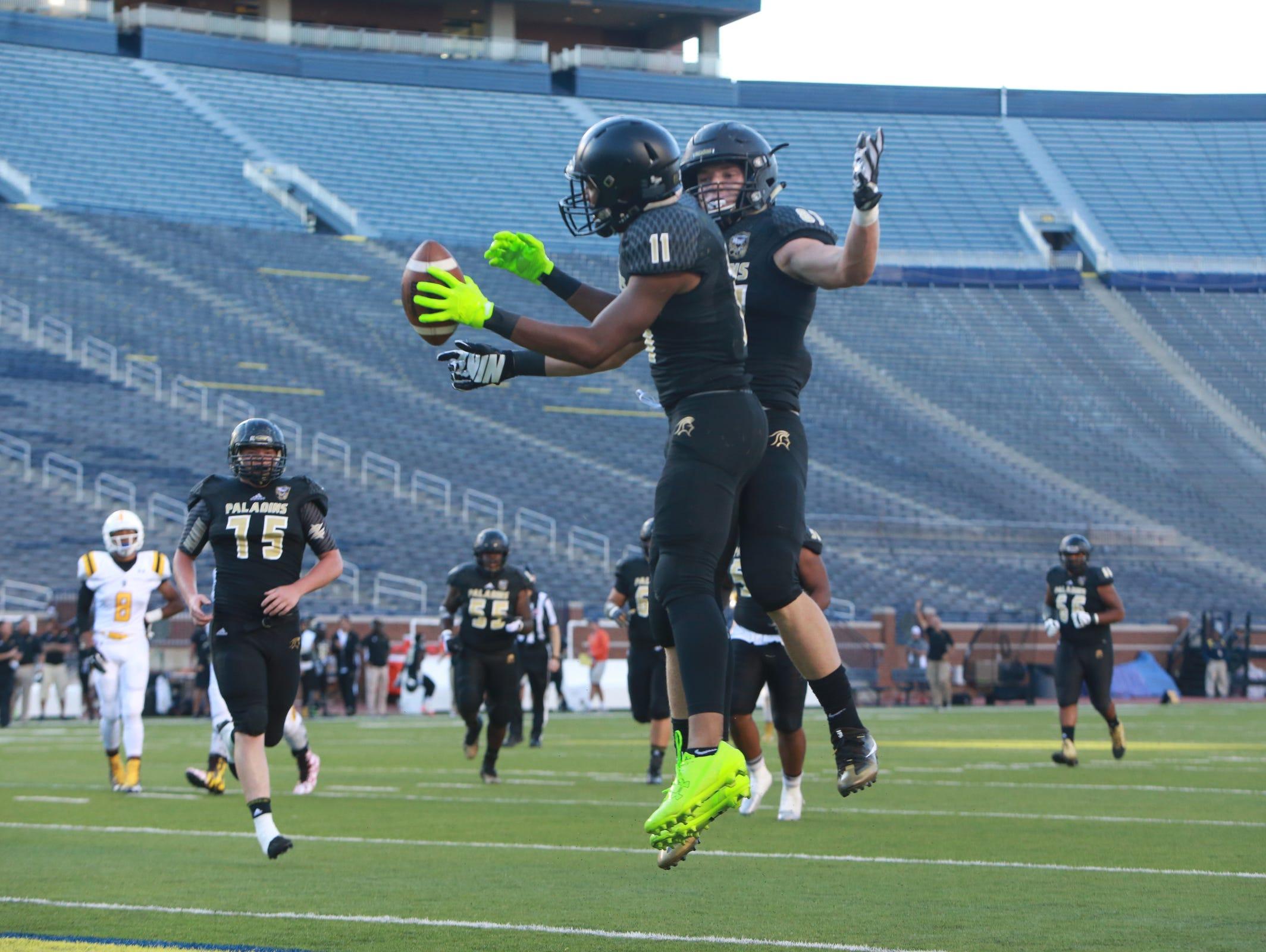 Paramus Catholic WR Javon Turner (11) celebrates in the end zone after a touchdown reception against St. Frances Academy during Paramus' 38-20 win Friday at Michigan Stadium.
