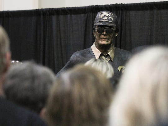 A bronze statue of former Iowa head coach Hayden Fry