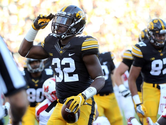 Iowa running back Derrick Mitchell Jr. celebrates a