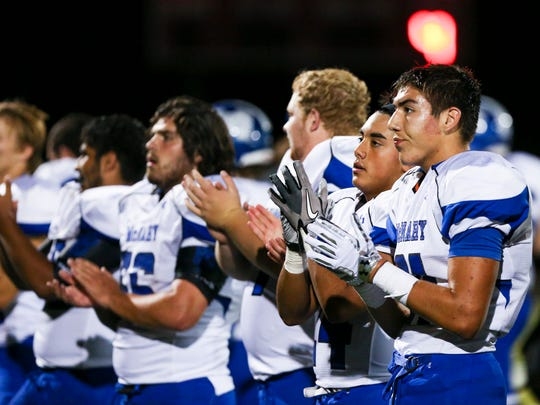 McNary players clap for their fans following a win over North Salem in the season opening-game on Friday, Sept. 2, 2016, at North Salem High School. McNary won the match-up 38-35.