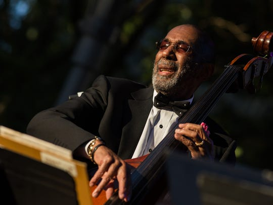 Ron Carter plays his double bass at the opening of
