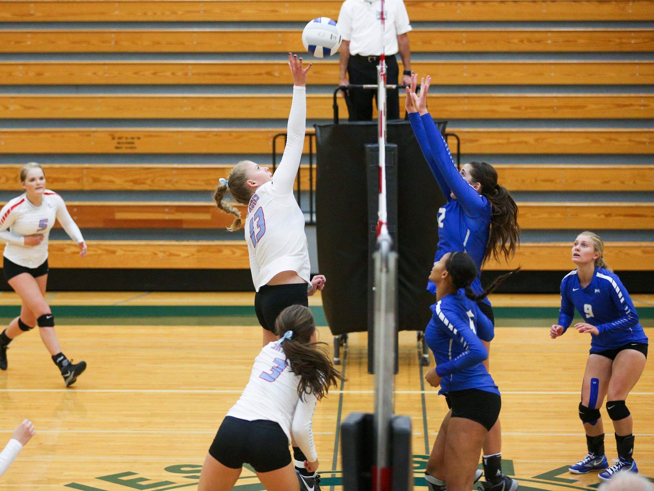 South Salem's Chloe Elmore (13) hits the ball over the net in a game on Tuesday, Sept. 6, 2016, at West Salem High School. The South Salem Saxons won the match-up 3-0.