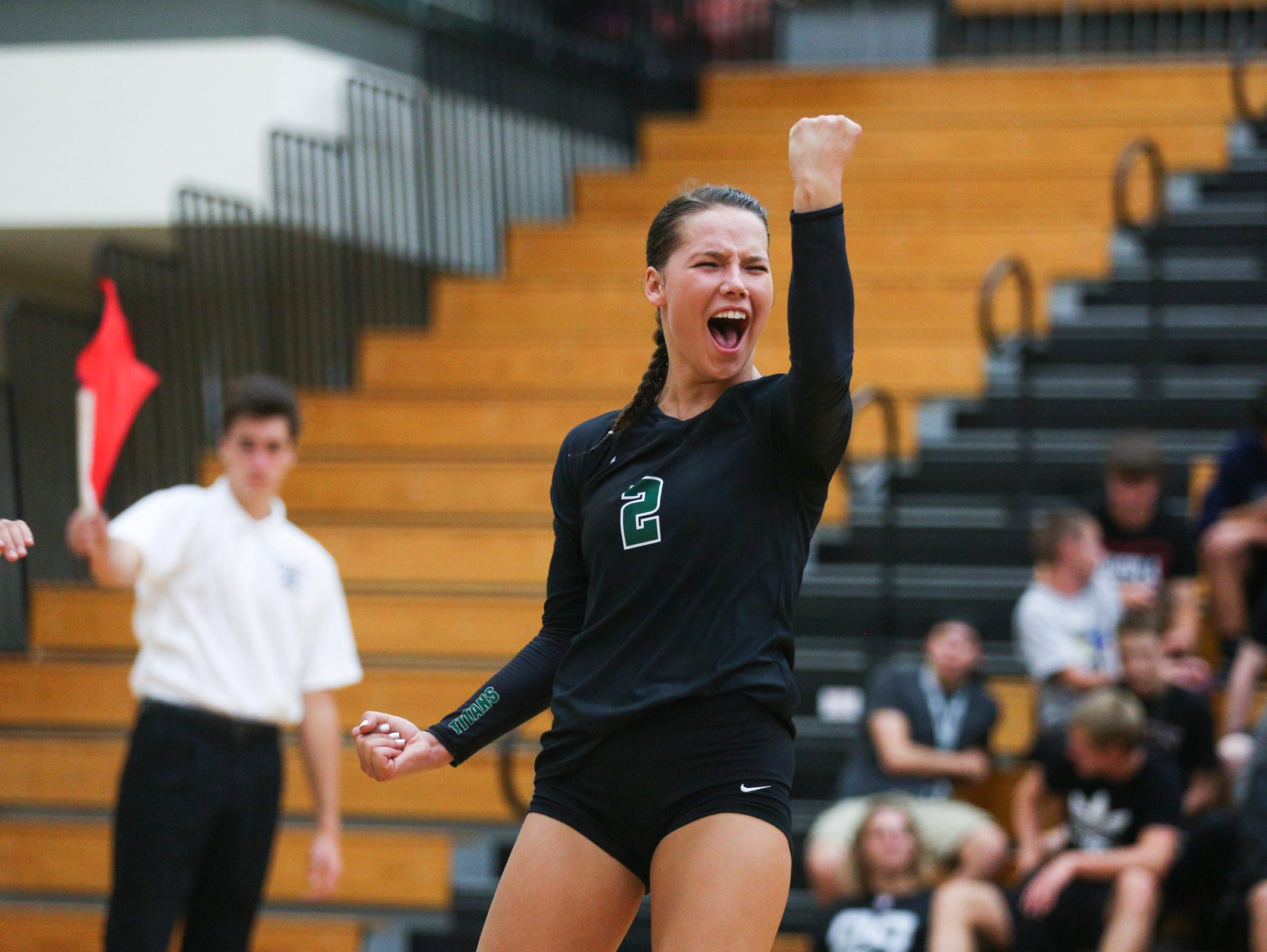 West Salem's Kasey Campbell celebrates after a the Titans are awarded a point in a game against South Salem on Tuesday, Sept. 6, 2016, at West Salem High School. The West Salem Titans won the match 3-1.