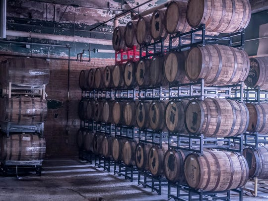 Beer barrels stacked neatly in the former production room at Arcadia Brewing Co. in Battle Creek.