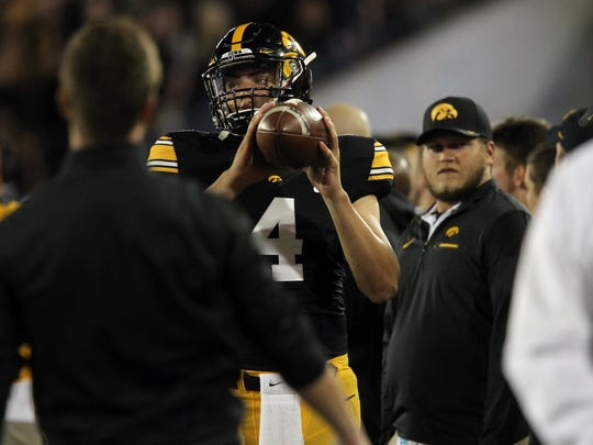 Iowa quarterback Nathan Stanley warms up during the Hawkeyes' game against Iowa State at Kinnick Stadium on Saturday, Sept. 10, 2016.