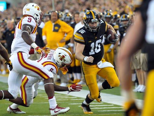 Iowa quarterback C.J. Beathard runs down field during