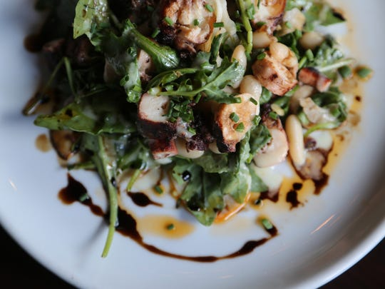 The octopus appetizer ($12) from Osteria Rossa in Grand Rapids is served with lemon conserva, pickled fennel, arugula, white beans and Calabrian chili oil.