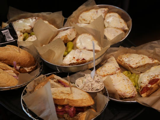 An array of sandwiches and French bread pizzas from Founders Brewing Co. in Grand Rapids. The brewery is both a sponsor and exhibitor of the annual ArtPrize public art competition.