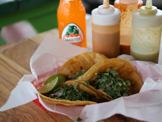 Tacos ($2-$2.50 ea/depending on protein) from Taqueria San Jose, a cash-only taqueria in a former drive-in restaurant in Grand Rapids.