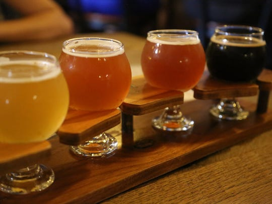 A flight of beer from Brewery Vivant, which serves