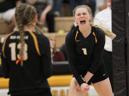 Mid-Prairie's Jaedynn Evans celebrates a point during the Golden Hawks' game against Mid-Prairie in Wellman on Tuesday, Sept. 13, 2016.