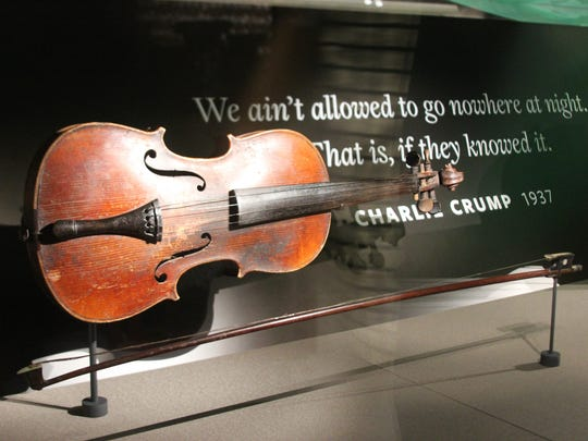 Violin donated by West Bloomfield's Shirley Burke is on display at the new National Museum of African American History and Culture in Washington D.C., press preview day on Wednesday Sept. 14. The museum opens to the publkic on Sept. 24. The violin belonged to her great grandfather who had been enslaved, and was passed down through the generations.