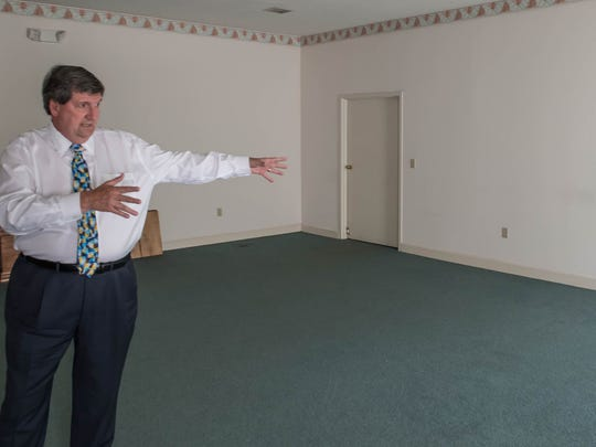 Craig Kempf show off a room where some of the renovations will occur at the former Shaw Funeral Home in Battle Creek.