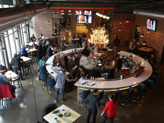 Punch Bowl Social brings classic entertainment such as bowling, ping pong, video games, private karaoke rooms with a gastro diner that serves breakfast, lunch and dinner  in Detroit on Tuesday, December 9, 2014.
