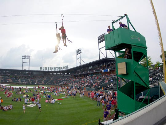SuperGames, the company setting up the zip line for the Lions game activities on Sunday, Sept. 18, 2016, runs a line outside Huntington Park, a minor league stadium, in Columbus, Ohio, in 2014.