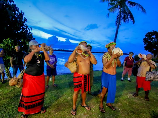 The kulu, or shell, trumpets are blown after the official