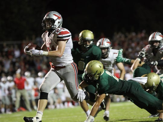 City High's Bryce Frantz runs in for a touchdown during
