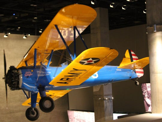 Restored Tuskegee Airman training aircraft hangs from the rafters at the new National Museum of African American History and Culture in Washington D.C., press preview day on Wednesday Sept. 14. The museum opens to the publkic on Sept. 24.