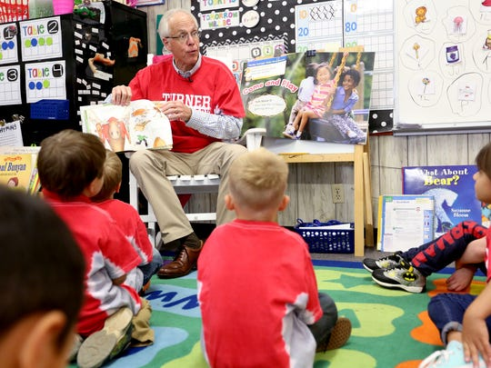 Dr. Bud Pierce reads to a kindergarten class at Turner