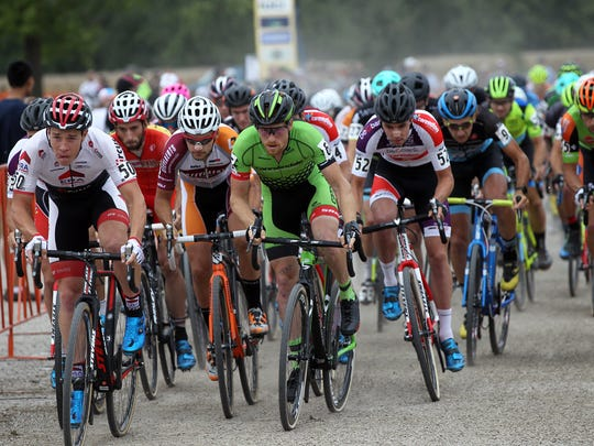 Cyclists make their way down the opening stretch during the UCI Jingle Cross C1 race at the Johnson County Fairgrounds on Sunday, Sept. 25, 2016.