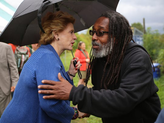 U.S. Senator Debbie Stabenow, D-Mich., thanks Malik Yakini of Detroit Black Community Food Security Network. Yakini said his group is one of hundreds of urban agriculture efforts across the city.
