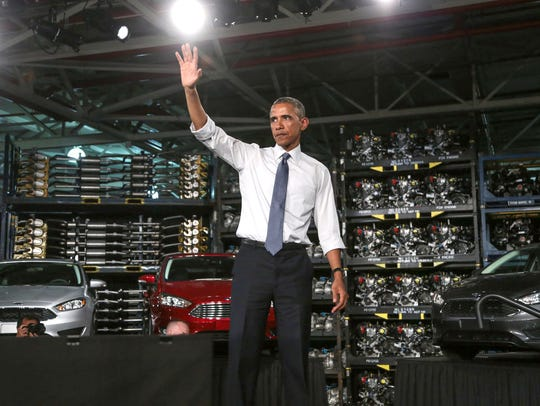 President Barack Obama waves to the crowd at the Ford