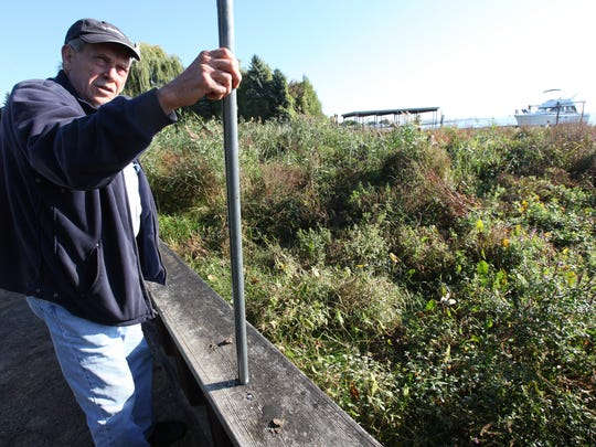 Doug Martz, a water quality advocate, held a rod to