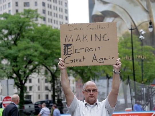 A counter-protester, who would not give his name, holds