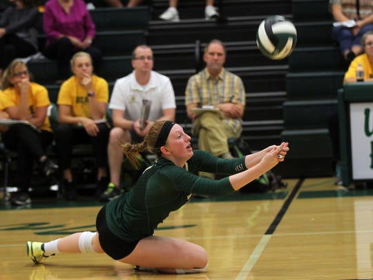 West High's Emma Norris dives for the ball during the