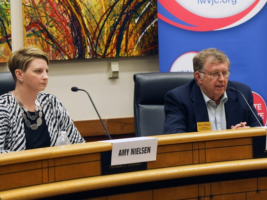 Iowa House candidates Amy Nielsen and Royce Phillips take part in a forum at the Coralville City Hall on Thursday, Oct. 6, 2016.