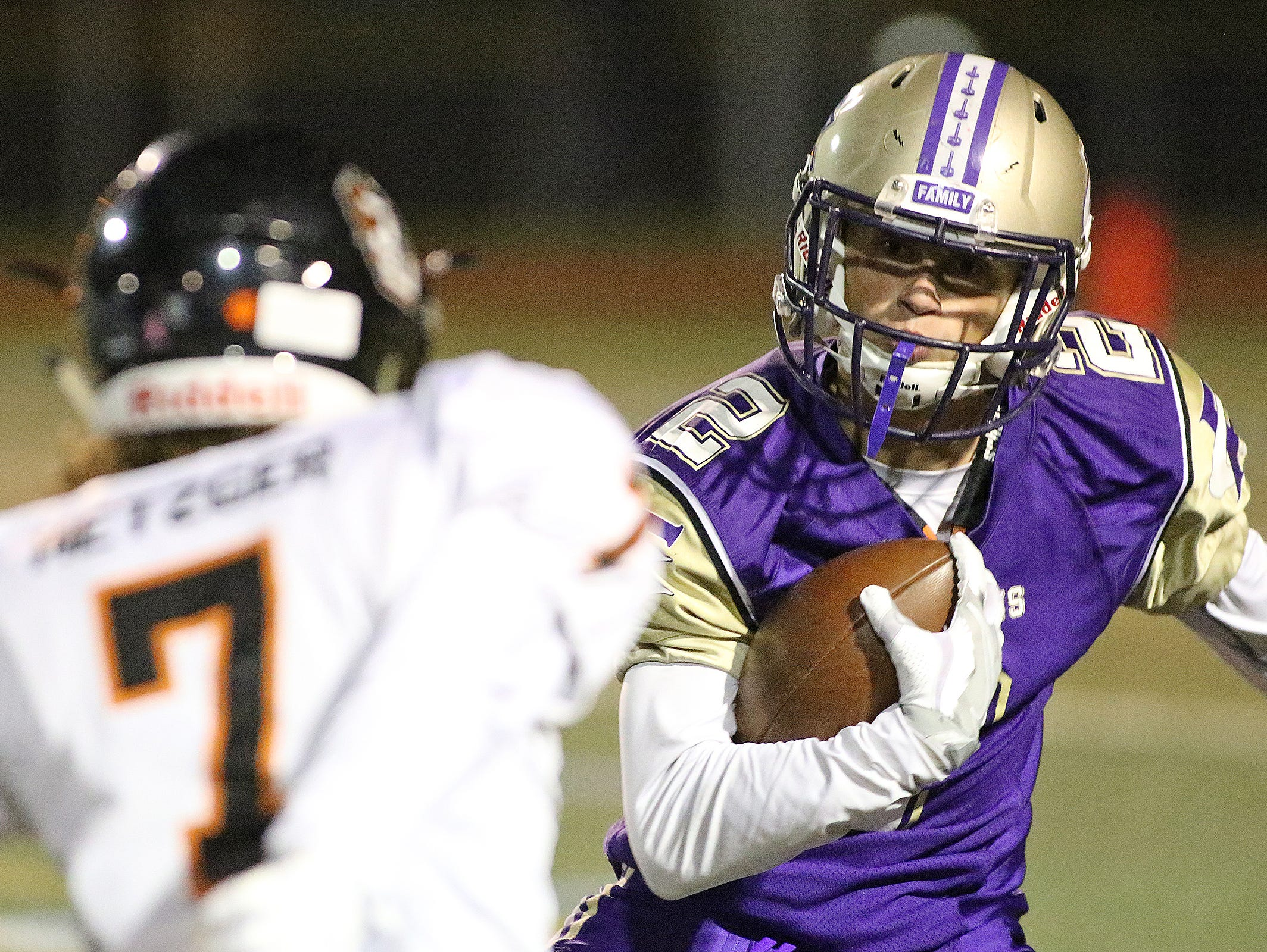 Lambkins punt returner Michael Kadlick jukes a defender during the Fort Collins Lambkins' 49-26 win over the Greeley Central Wildcats on Friday, Oct. 7, 2016 in Fort Collins, Colo. (Photo by Brian Smith/for the Coloradoan)