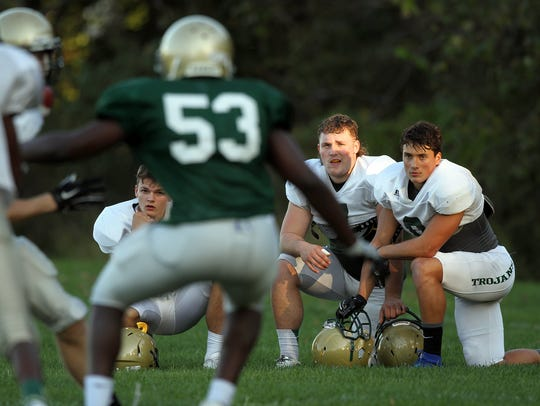 West High's Oliver Martin watches teammates during