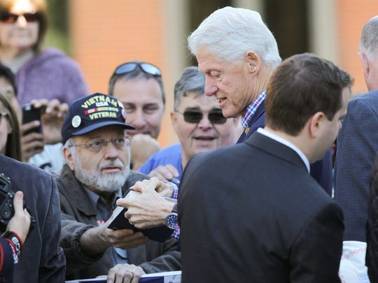 Former President Bill Clinton greets guests at Cornell College in Mount Vernon while campaigning for his wife on Thursday, Oct. 13, 2016.