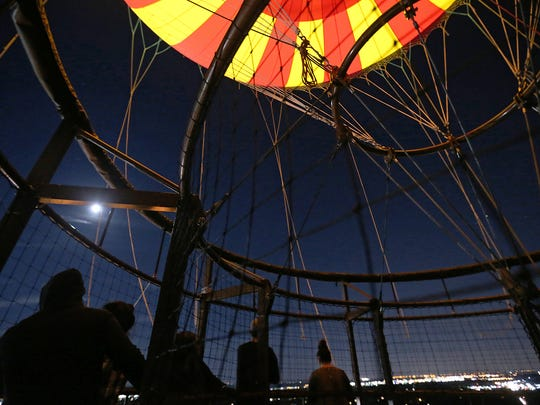 Adventurous prairie-goers take a night time ride on the 1859 balloon voyage on opening night of Headless Horseman Nights at Conner Prairie, Fishers, Ind., Thursday, October 13, 2016.
