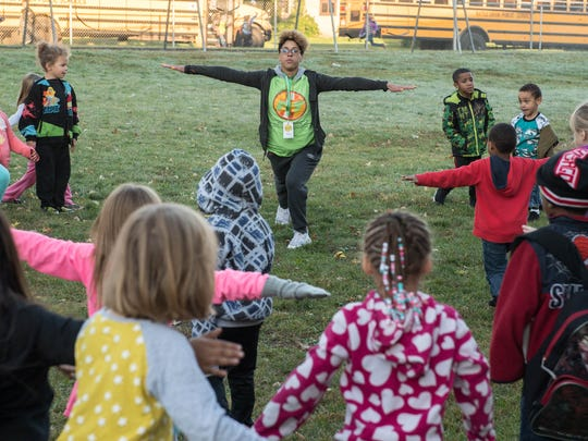 """Operation Fit's Shara Jamierson works with students as part of their """"Morning Movement Program"""" at Post-Franklin."""