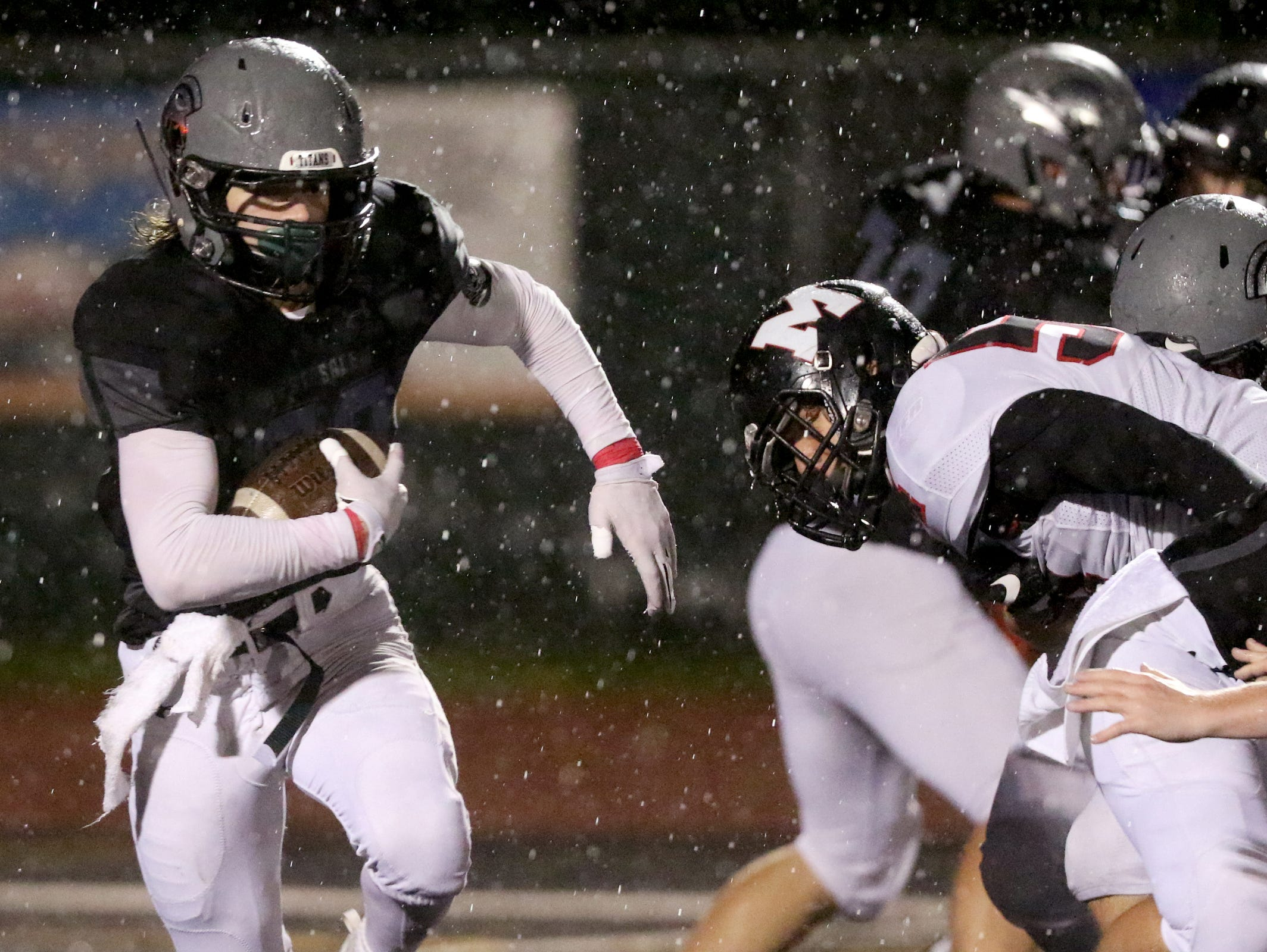 West Salem's Noah Whitaker (20) runs with the ball in the second half of the McMinnville vs. West Salem football game at West Salem High School on Thursday, Oct. 13, 2016. West Salem won the game 16-8.