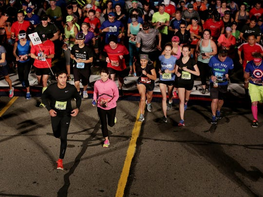 Runners cross the start line during the 39th annual Detroit Free Press marathon in Detroit on Sunday, Oct. 16, 2016.