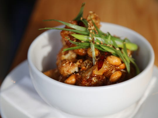 The sweet and spicy kung pao cauliflower from the Morrie in Royal Oak is a different spin on the orange cauliflower served at sister restaurant Bistro 82.
