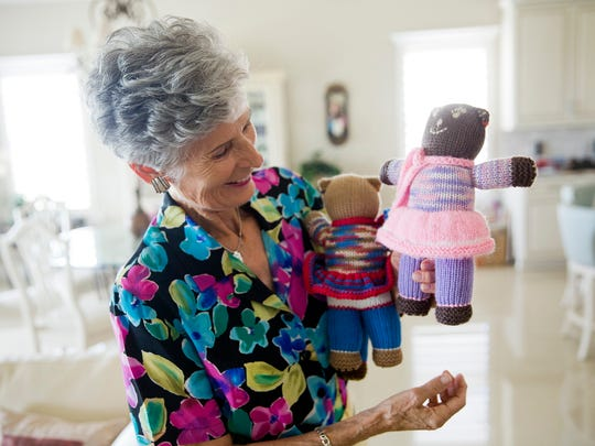 Cornelia Vifian with her next shipment of hand-knit bears in her home Thursday, Oct. 13, in Bonita Springs. Over the years Cornelia has created 200 bears all of which will have been sent to Africa for underprivileged youth and orphans.