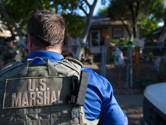 U.S. Marshals, Corpus Christi Police Department and the Nueces County Sheriff's Office execute an arrest warrant as they take part in the 14th Annual National Family Violence Apprehension Detail on Wednesday, Oct. 19, 2016.