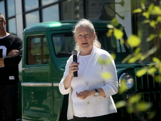 Sue Mosey of Midtown Detroit Inc., speaks during a past ribbon-cutting ceremony in Midtown.