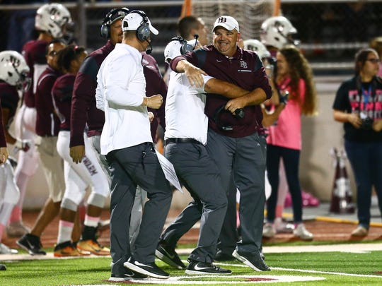 Flour Bluff's head coach Chris Steinbruck celebrates after defeating Carroll 41-27 at Hornet Stadium on Friday, Oct. 2016