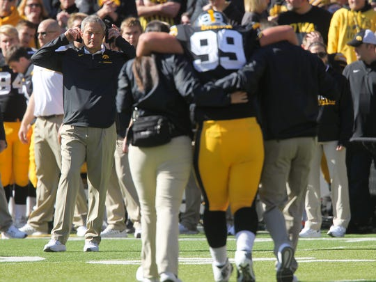 Iowa head coach Kirk Ferentz watches as Nathan Bazata is walked to the sidelines during the Hawkeyes' game against Wisconsin at Kinnick Stadium on Saturday, Oct. 22, 2016.