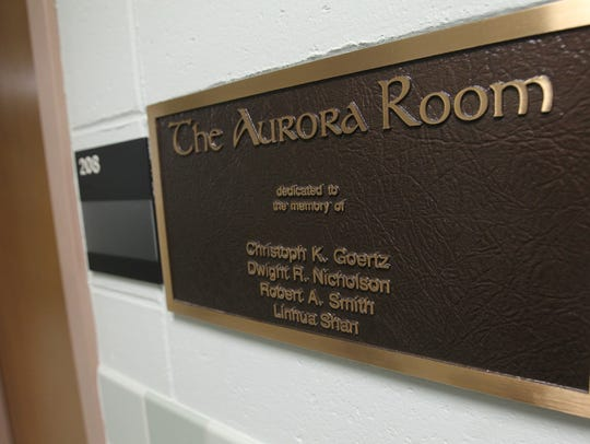 A plaque hangs outside the Aurora Room inside Van Allen