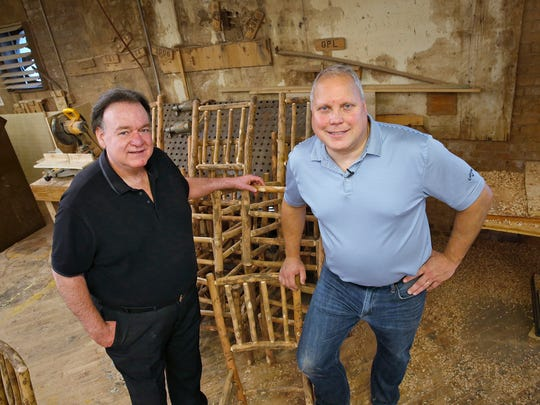 Rocco Liott, president of Old Hickory Furniture Co., left, and Bob Morrison, VP of sales and marketing pose with some hickory pieces on their way to become chairs, made at the Shelbyville company, Thursday, September 22, 2016.
