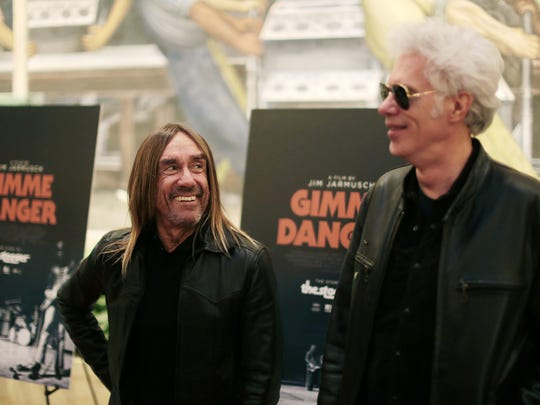 Director Jim Jarmusch (right) and Iggy Pop pose for a photo on the red carpet before the screening of Jarmusch's new Stooges documentary 'Gimme Danger' at the Detroit Film Theatre at the Detroit Institute of Arts on Tuesday October 25, 2016.