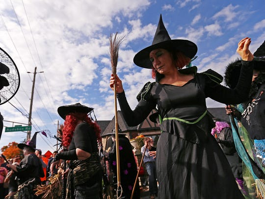 Witches from the Irvington Black Hat Society stop to