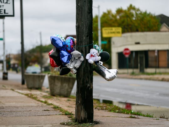 Balloons hang from a pole where Detroit Police officer Myron Jarrett was killed by a hit-and-run driver on Oct. 28, 2016, at the corner of Puritan and Monica, a few blocks away from University of Detroit Mercy in Detroit, photographed on Sunday, Oct. 30, 2016.