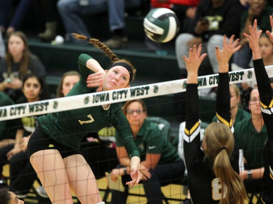 West High's Emma Norris goes for a kill during the